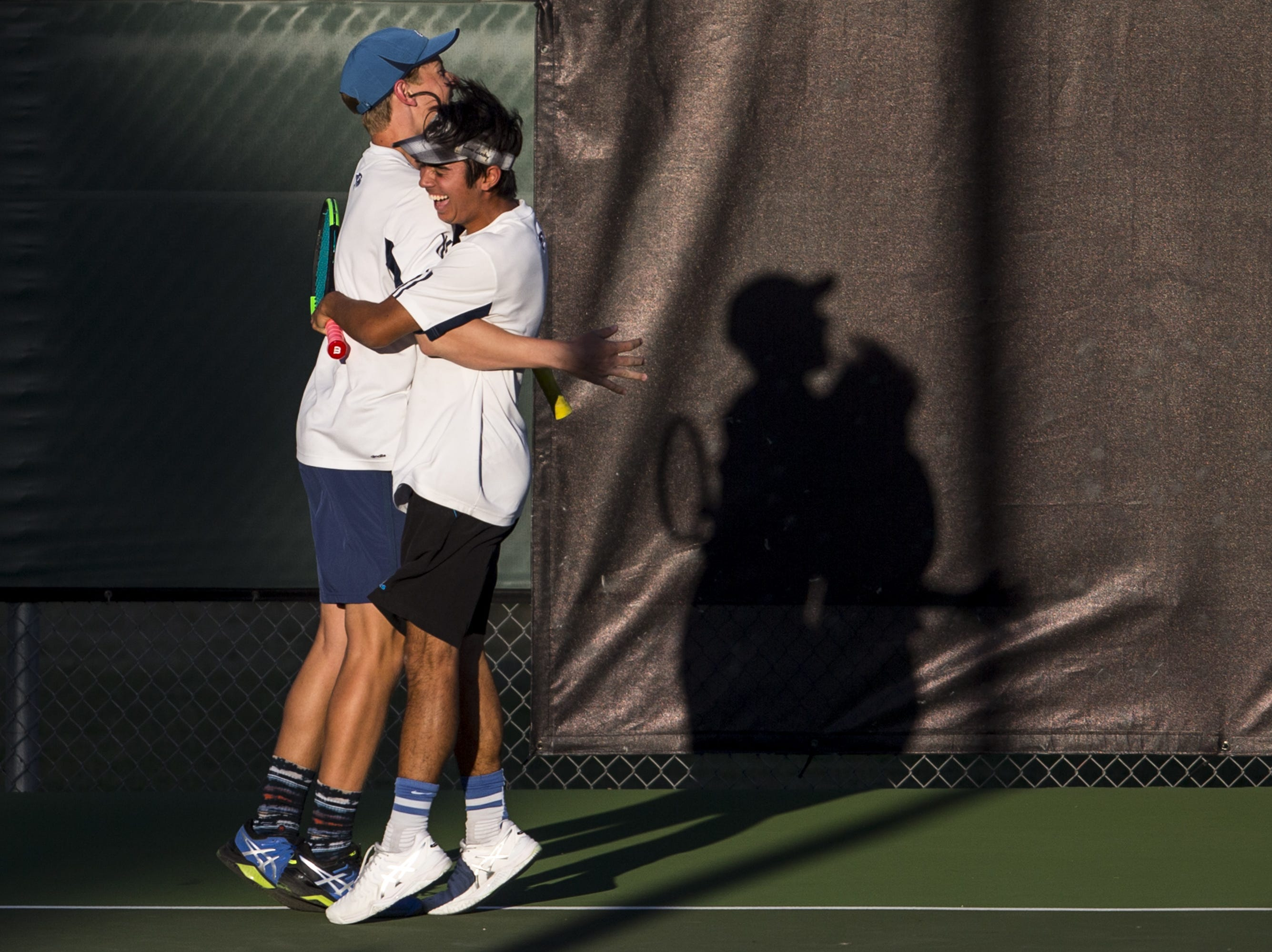 Cactus Shadows' Ryan Hildebrand (left) and Harry Carrozza celebrate after defeating Catalina Foothills for the Division II Boys Tennis Doubles State Championship on Monday, April 29, 2019, at Whiteman Tennis Center in Tempe, Ariz.