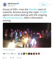 U.S. Customs and Border Protection released a photo of the Central American migrants as they surrendered to Border Patrol agents.