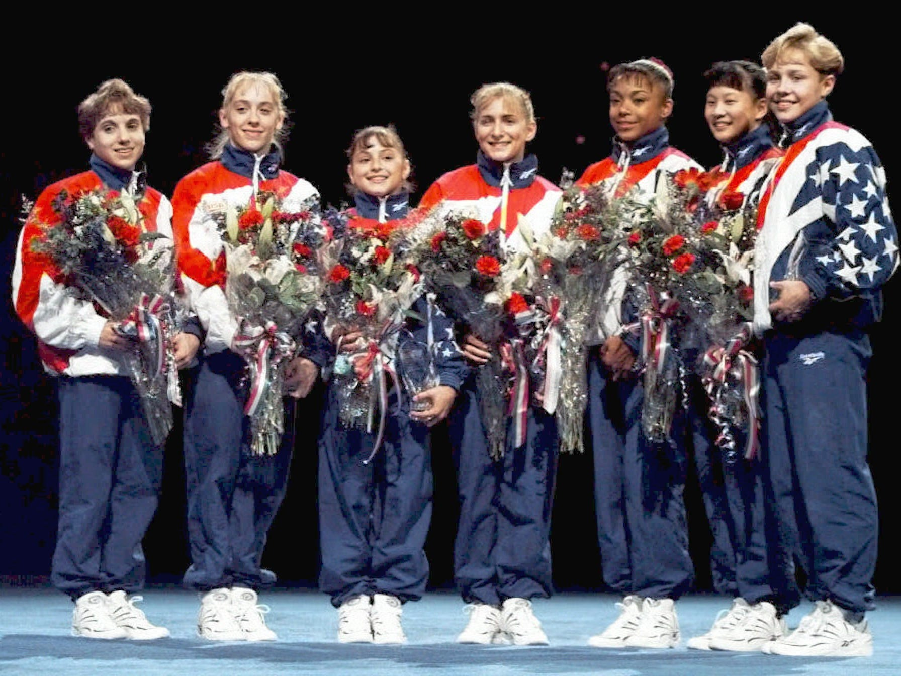 Amanda Borden, far right, was a the captain of the 1996 U.S. women's gymnastics team, which won the gold medal at the Atlanta Games.