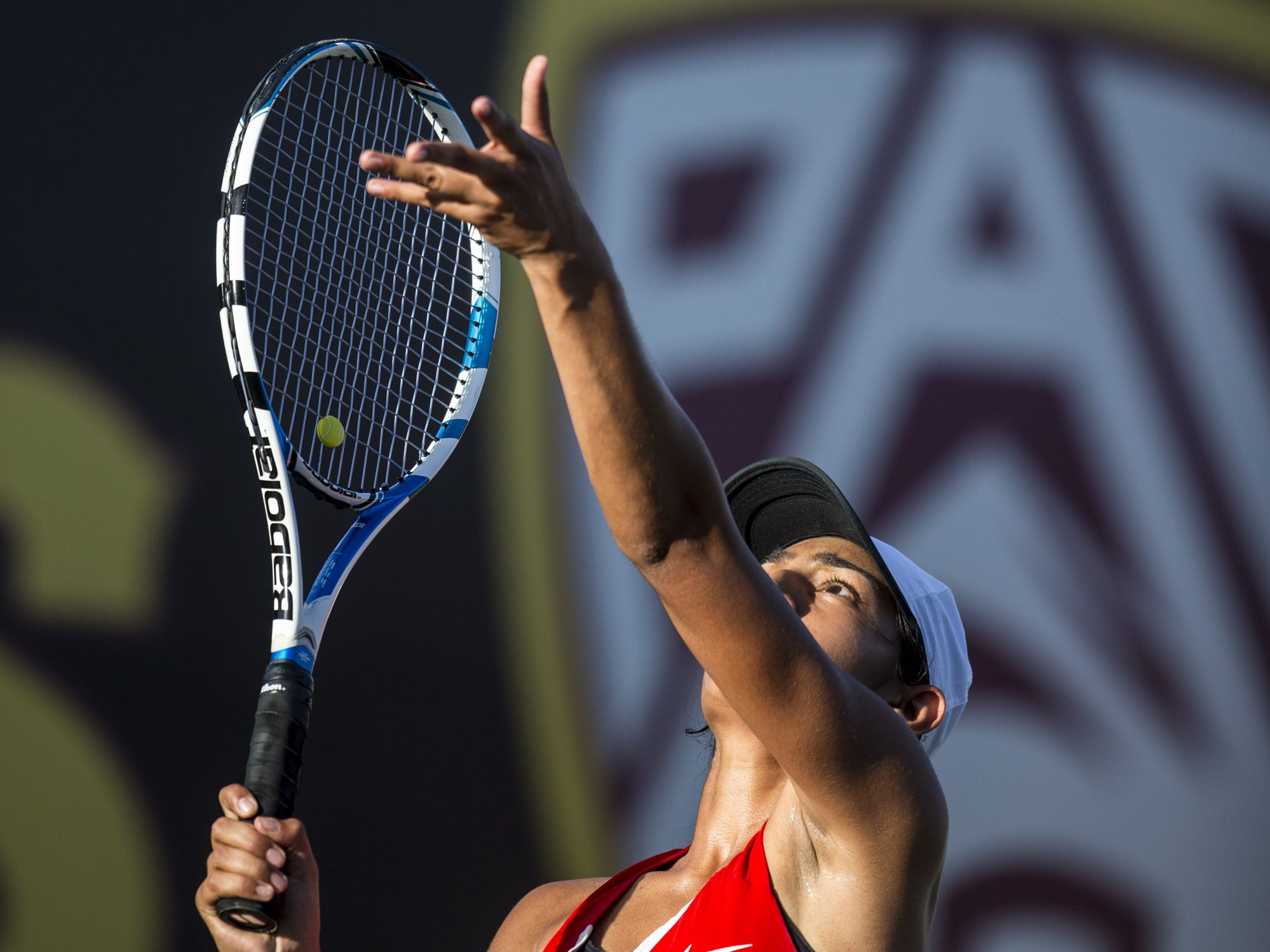 Chandler Prep's Sangeet Bhalla serves against Pusch Ridge's Sofia Fetsis during the Division III Girls Tennis Singles State Championship on Monday, April 29, 2019, at Whiteman Tennis Center in Tempe, Ariz.