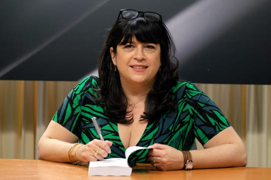 "Author E.L. James signs a copy of ""Grey: Fifty Shades of Grey as Told by Christian"" on June 18, 2015, in New York."
