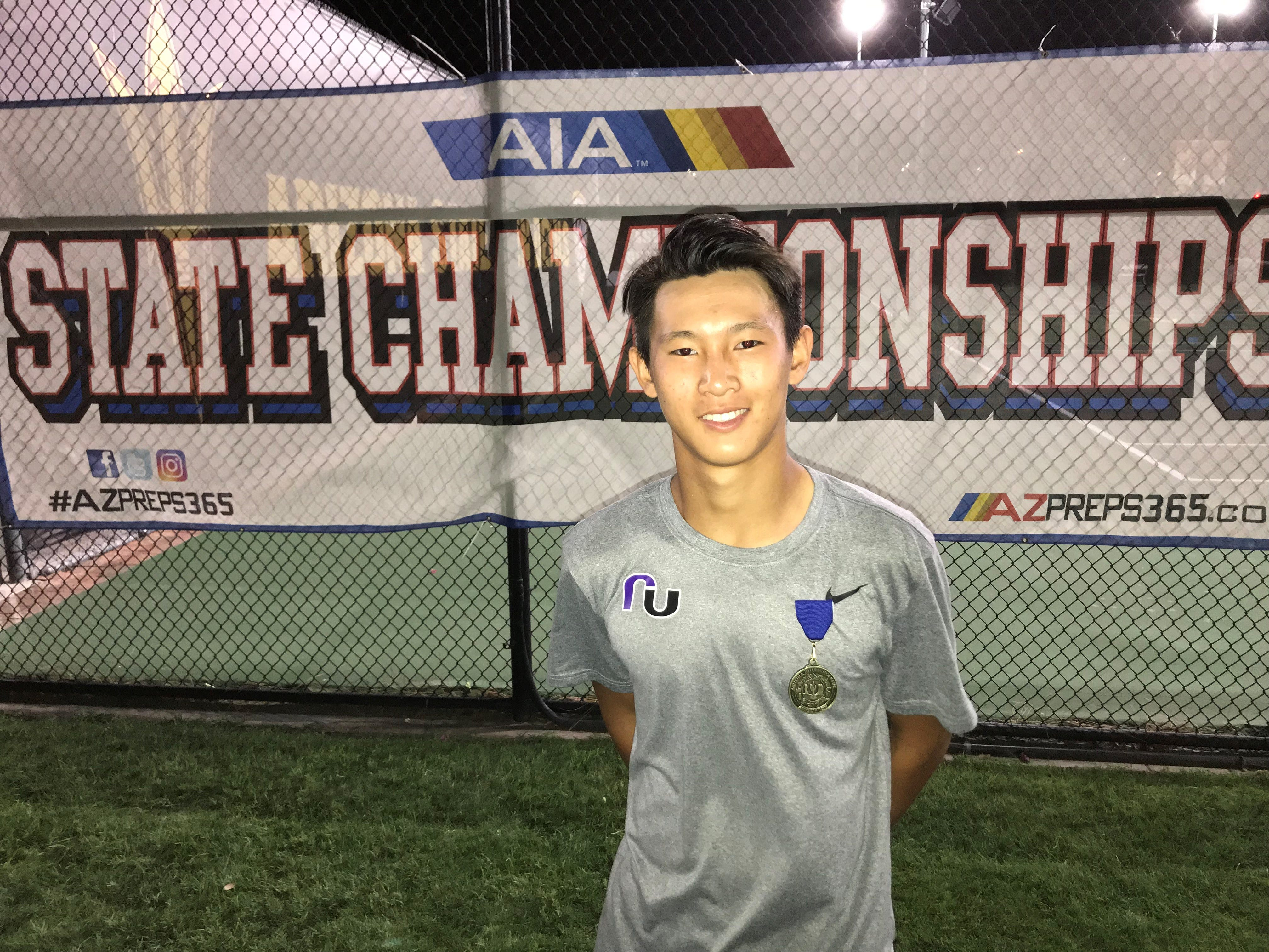 April 29, 2019; Ethan Lee of Rincon/University wins his first Division I singles state title at ASU Whiteman Center.