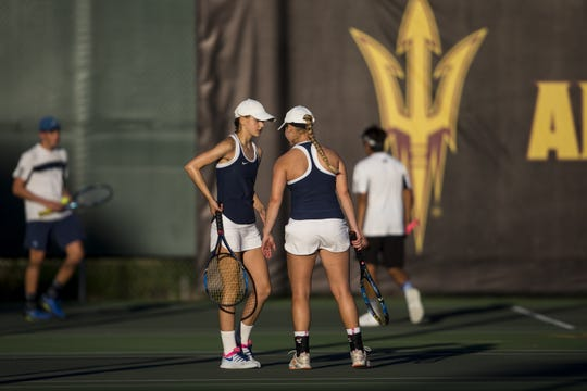 Cactus Shadows' Nicole Quenzler talks to Danielle Quenzler during the Division II Girls Tennis Doubles State Championship against Notre Dame Prep on Monday, April 29, 2019, at Whiteman Tennis Center in Tempe, Ariz.