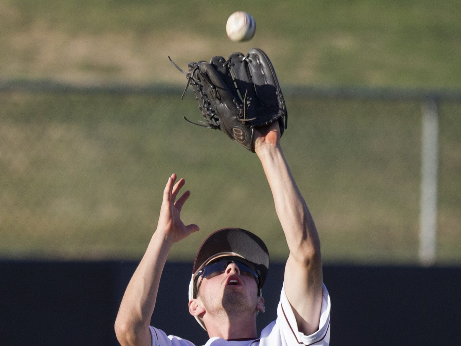 Desert Mountain left fielder Drake Mueller catches a fly ball during their game against Sunrise Mountain in the 5A state baseball second round at Diablo Stadium in Tempe, Arizona, April 29, 2019.