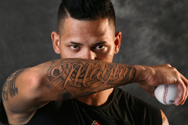 Arizona Diamondbacks pitcher Yoan Lopez has tattoos of important life moments .