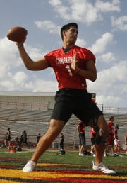 Chaparral's Jack Miller throws a pass during practice at Chaparral High School in Scottsdale, Ariz. on April 29, 2019.