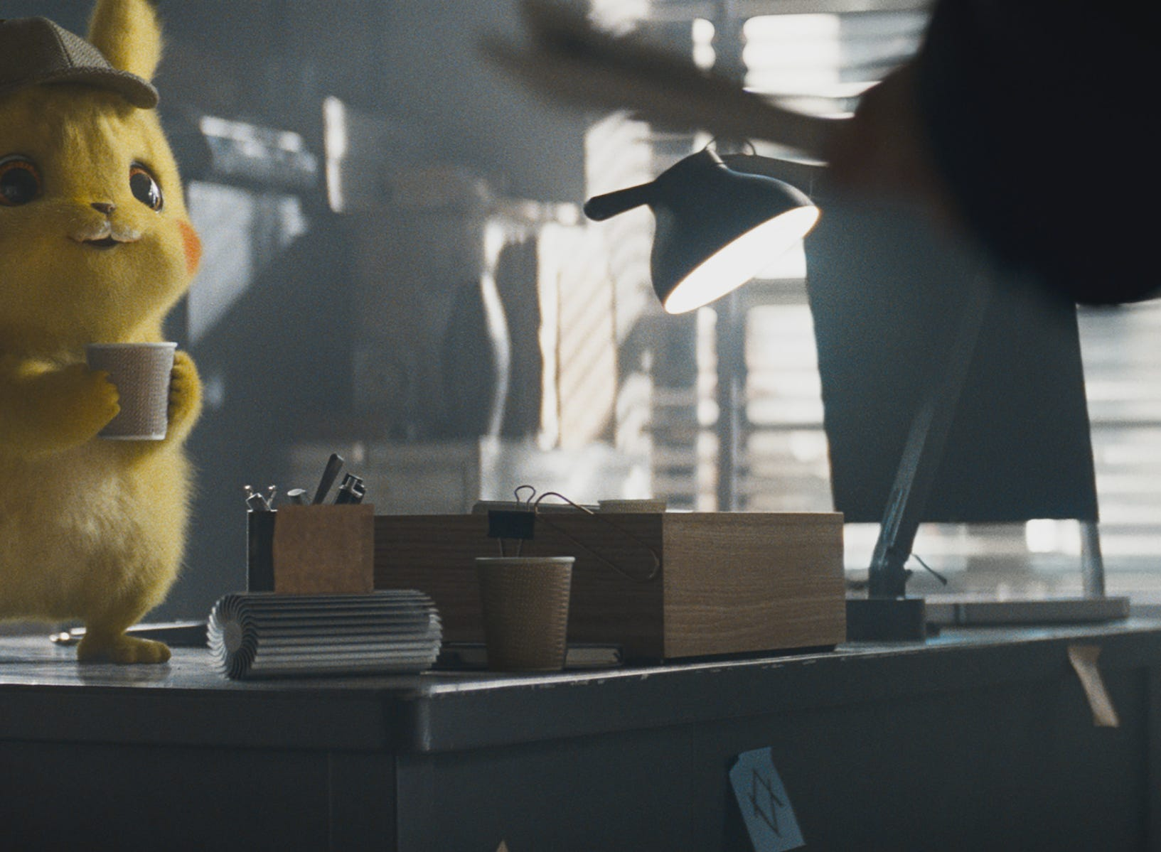 "Pikachu (voiced by Ryan Reynolds) is addicted to caffeine in ""Pokemon Detective Pikachu."""