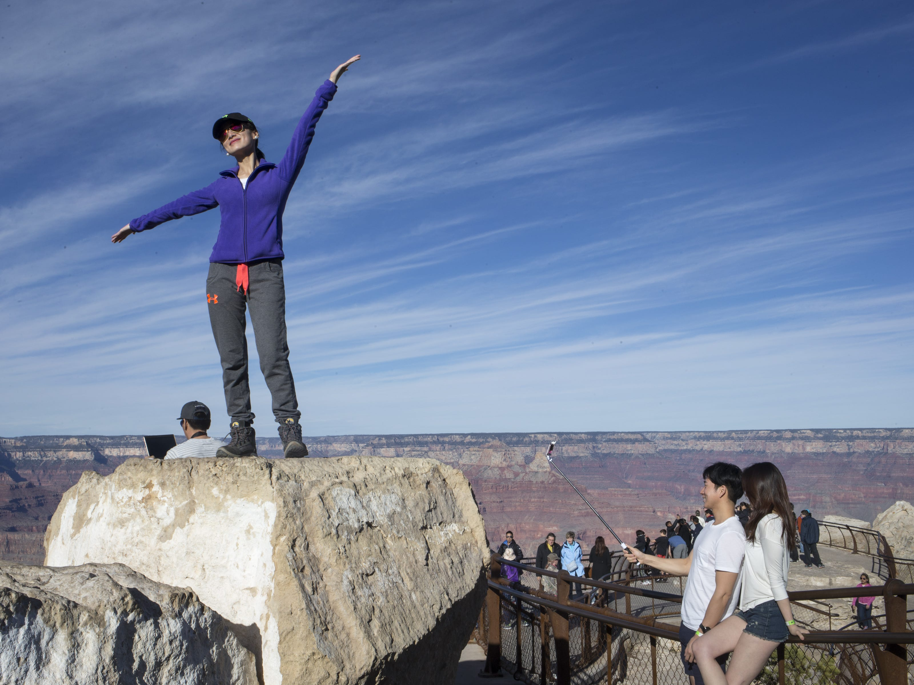 Visitors to Grand Canyon National Park pose for photos at Mather Point on the Canyon's South Rim.