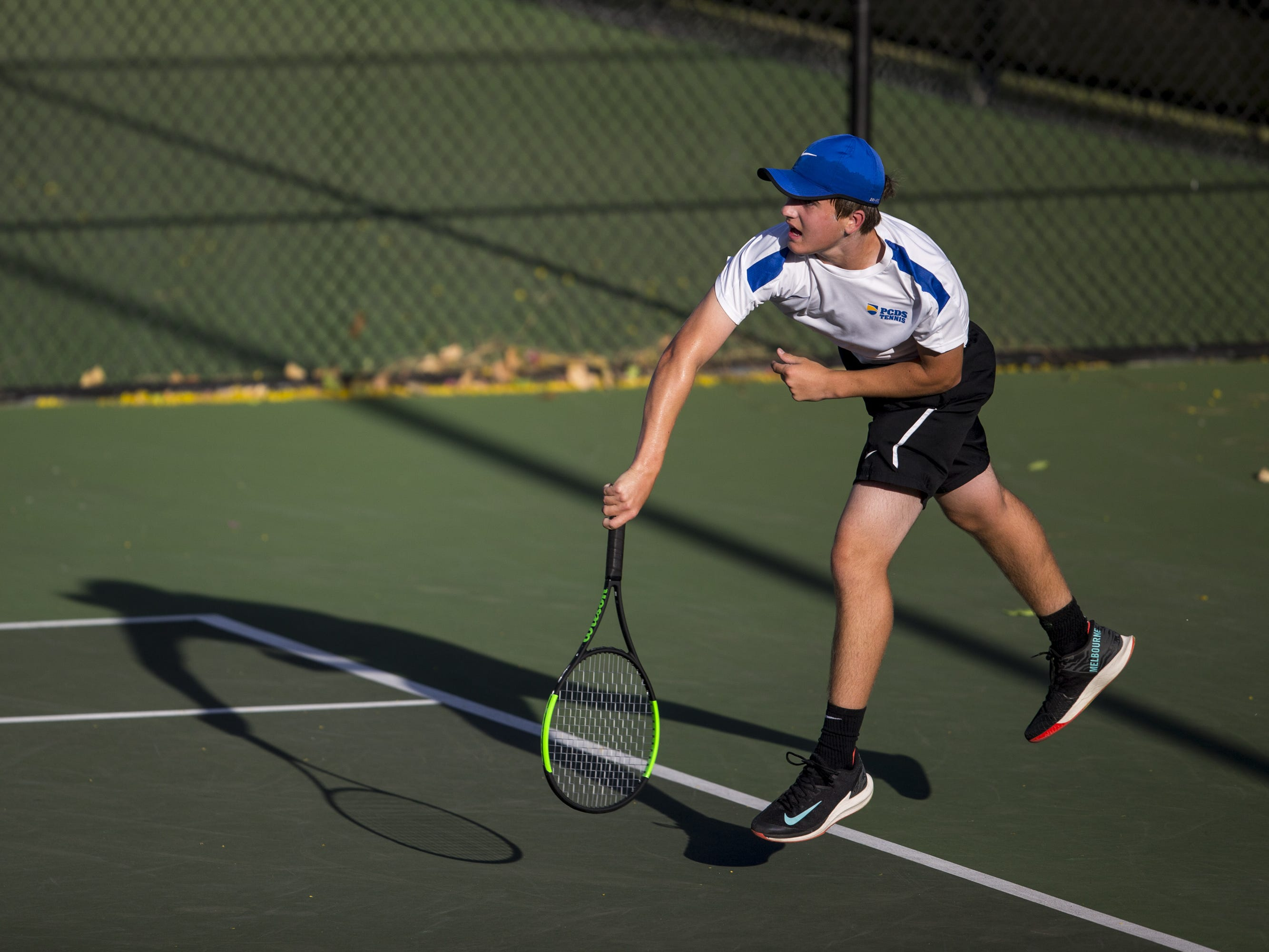 Phoenix Country Day's Ashton Kroeger serves against The Gregory School's Wilder Cooke during the Division III Boys Tennis Singles State Championship on Monday, April 29, 2019, at Whiteman Tennis Center in Tempe, Ariz.