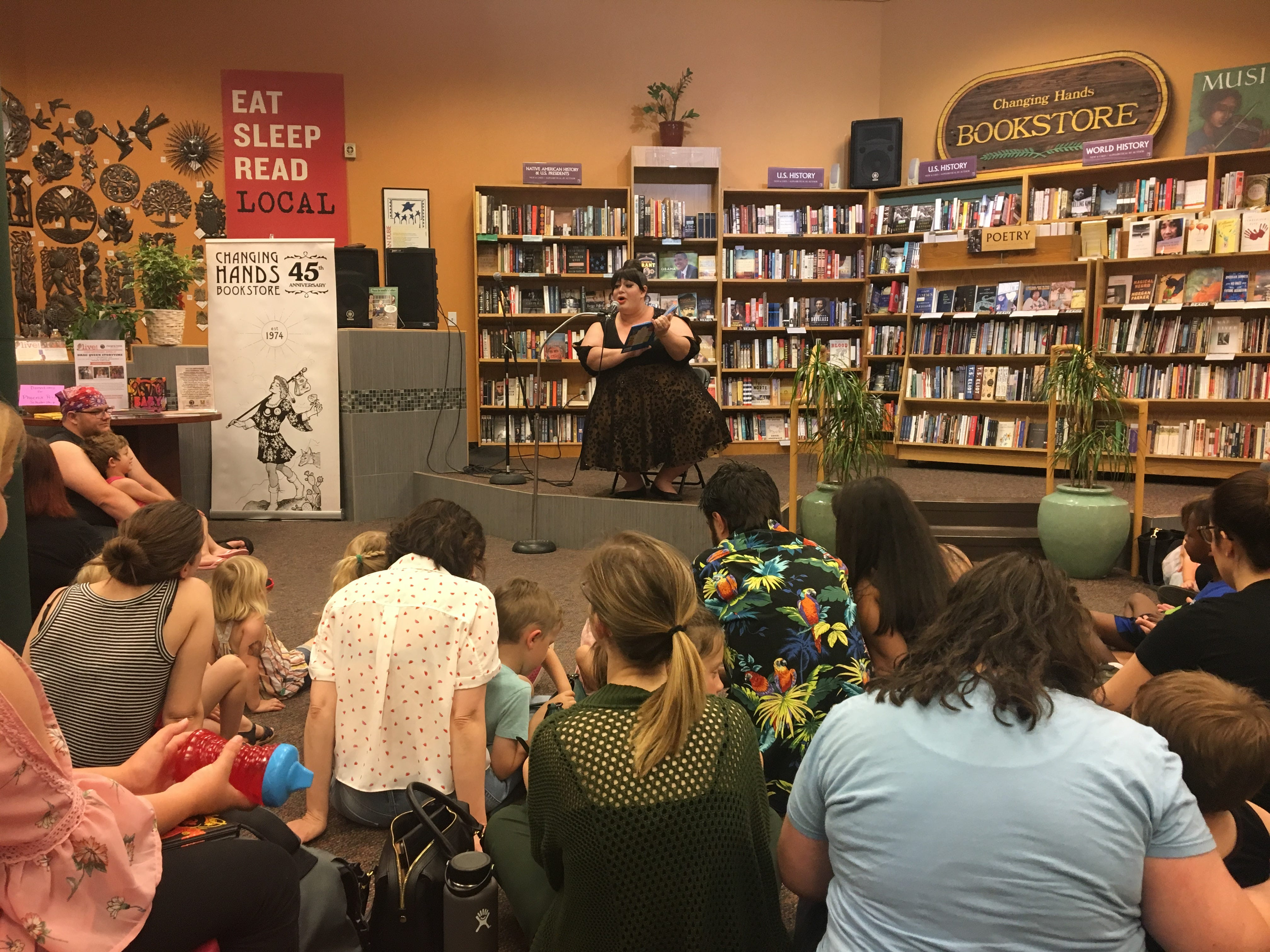 "Drag queen Sophia Sinclair reads aloud from ""It's Not Easy Being a Bunny"" at Drag Queen Story Time  at Changing Hands Bookstore in Tempe."