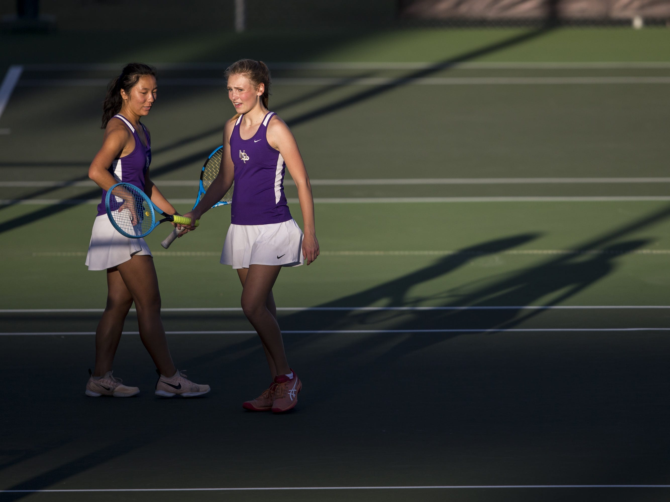 Notre Dame Prep's Natalie Hoffman (left) and Maysa Tuftin talk during the Division II Girls Tennis Doubles State Championship against Cactus Shadows on Monday, April 29, 2019, at Whiteman Tennis Center in Tempe, Ariz.