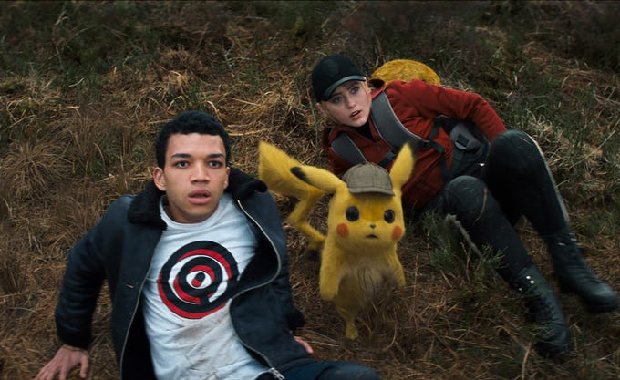 "Tim (Justice Smith) and Pikachu (voiced by Ryan Reynolds) partner with Lucy (Kathryn Newton) and her Psyduck to solve the case in ""Pokemon Detective Pikachu."""