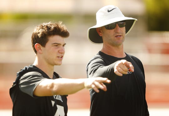Chaparral's head coach Brent Barnes talks to safety Ashton Liddell during practice at Chaparral High School in Scottsdale, Ariz. on April 29, 2019.