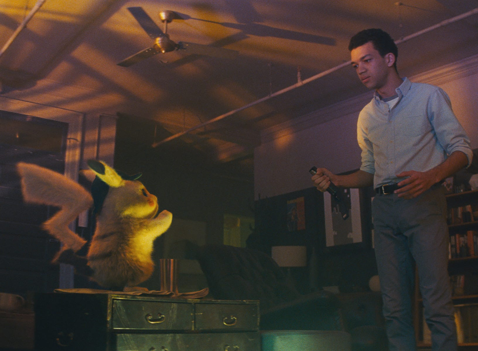 "Tim (Justice Smith) is the only human who can communicate with Pikachu (voiced by Ryan Reynolds) in ""Pokemon Detective Pikachu."""