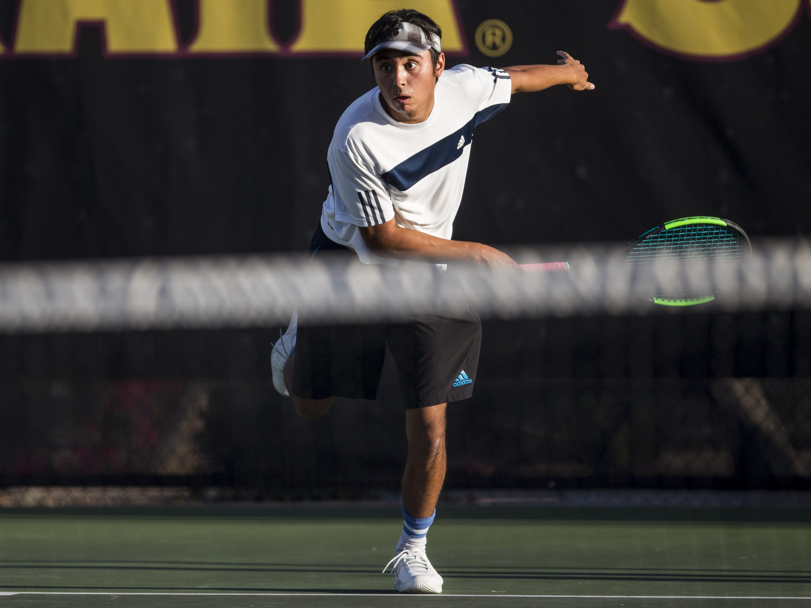 Cactus Shadows' Harry Carrozza returns the ball against Catalina Foothills during the Division II Boys Tennis Doubles State Championship on Monday, April 29, 2019, at Whiteman Tennis Center in Tempe, Ariz.