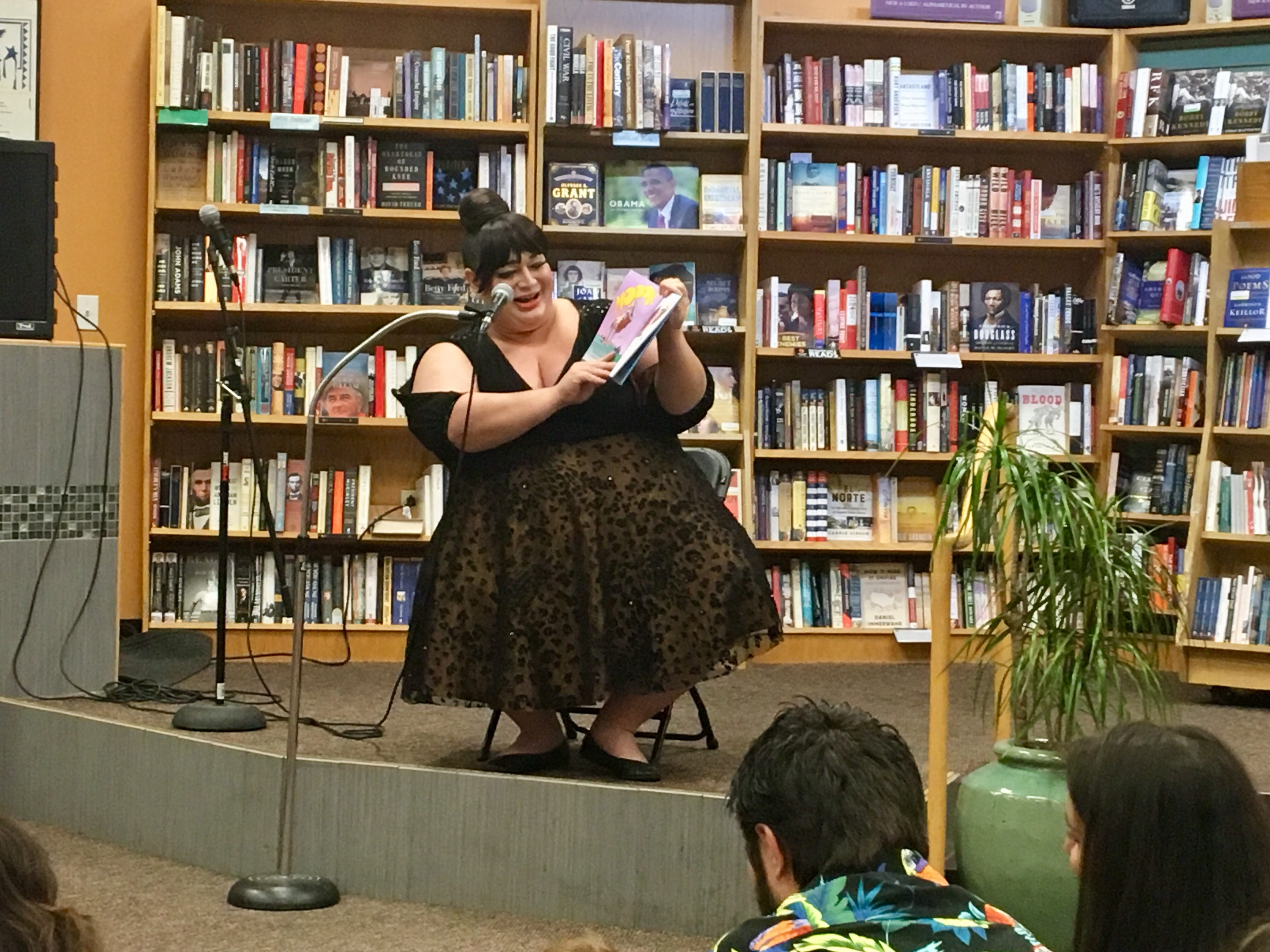 "Drag queen Sophia Sinclair read ""It's Not Easy Being a Bunny,"" which is about P.J. who didn't like being a rabbit – the big ears, so many siblings - at Drag Queen Storytime at Changing Hands Bookstore in Tempe."
