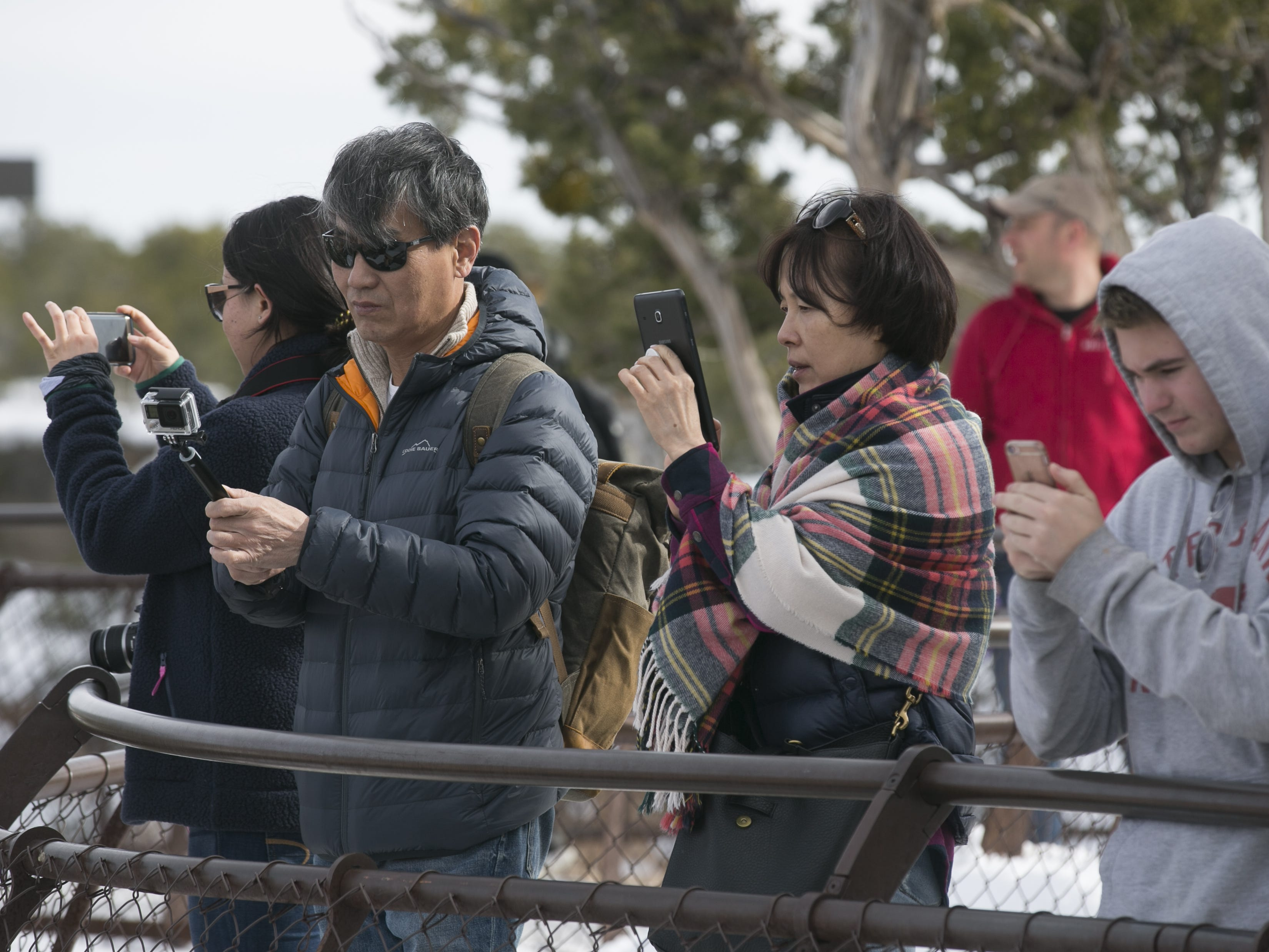 Visitors gather at one of the overlooks at Grand Canyon National Park.