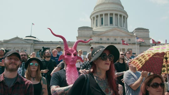 "Supporters of the Satanic Temple attend a rally for religious liberty in Little Rock, Arkansas, in ""Hail Satan?"""