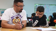 Sonny Cruz of Watch D.O.G.S. reads with Paulo Porras on April 30, 2019, in his third-grade classroom at Tartesso Elementary School in Buckeye.