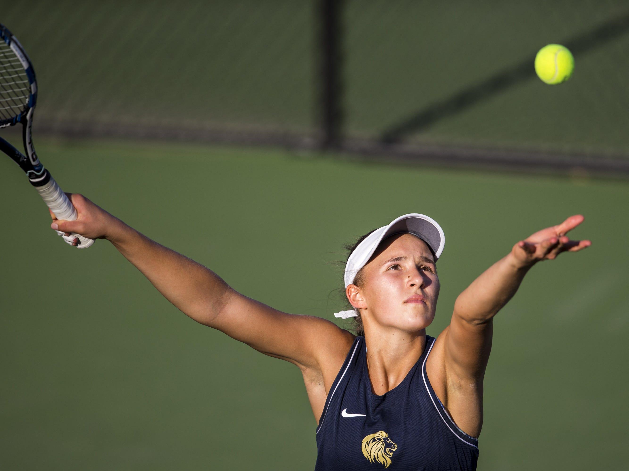 Pusch Ridge's Sofia Fetsis serves against Chandler Prep's Sangeet Bhalla during the Division III Girls Tennis Singles State Championship on Monday, April 29, 2019, at Whiteman Tennis Center in Tempe, Ariz.