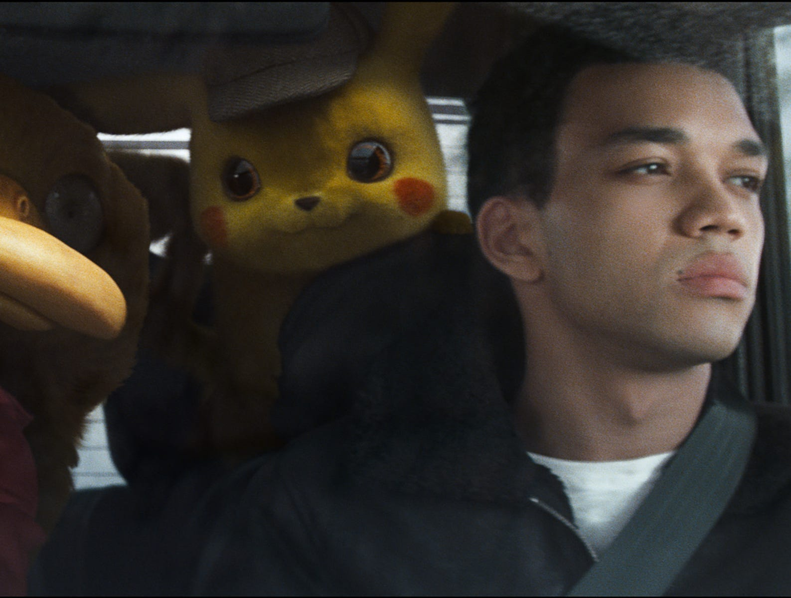 "Lucky (Kathryn Newton) and Tim (Justice Smith) go on an adventure with their Pokemon partners to uncover secrets behind his father's death in ""Pokemon Detective Pikachu."""