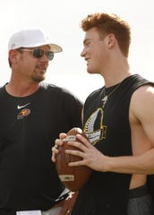 Chaparral's offensive coordinator Tim Kohner talks with wideout Tommy Christakos during practice at Chaparral High School in Scottsdale, Ariz. on April 29, 2019.