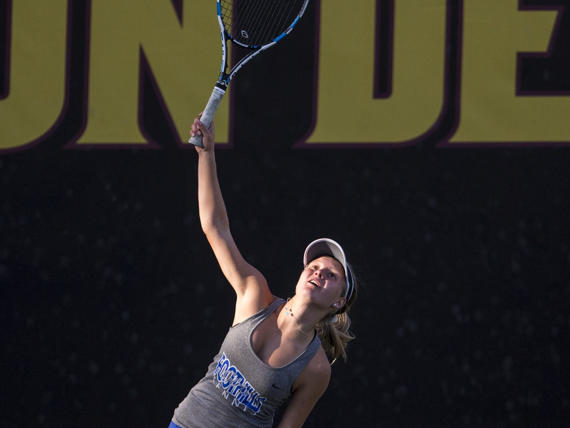Catalina Foothills' Annabelle Mulick serves against Catalina Foothills' Emily Flowers during the Division II Girls Tennis Singles State Championship on Monday, April 29, 2019, at Whiteman Tennis Center in Tempe, Ariz.