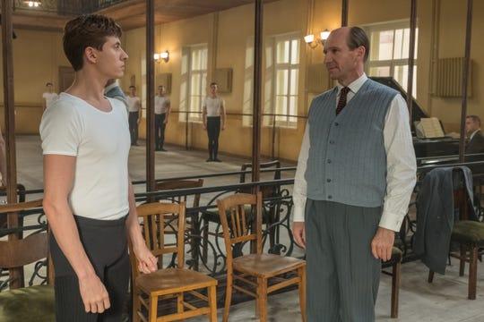 "Nureyev (Oleg Ivenko) speaks with Pushkin (Ralph Fiennes) in ""The White Crow."""