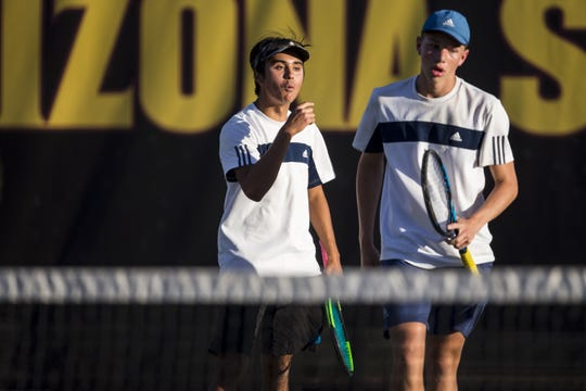 Cactus Shadows' Harry Carrozza (left) encourages Ryan Hildebrand during the Division II Boys Tennis Doubles State Championship against Catalina Foothills on Monday, April 29, 2019, at Whiteman Tennis Center in Tempe, Ariz.