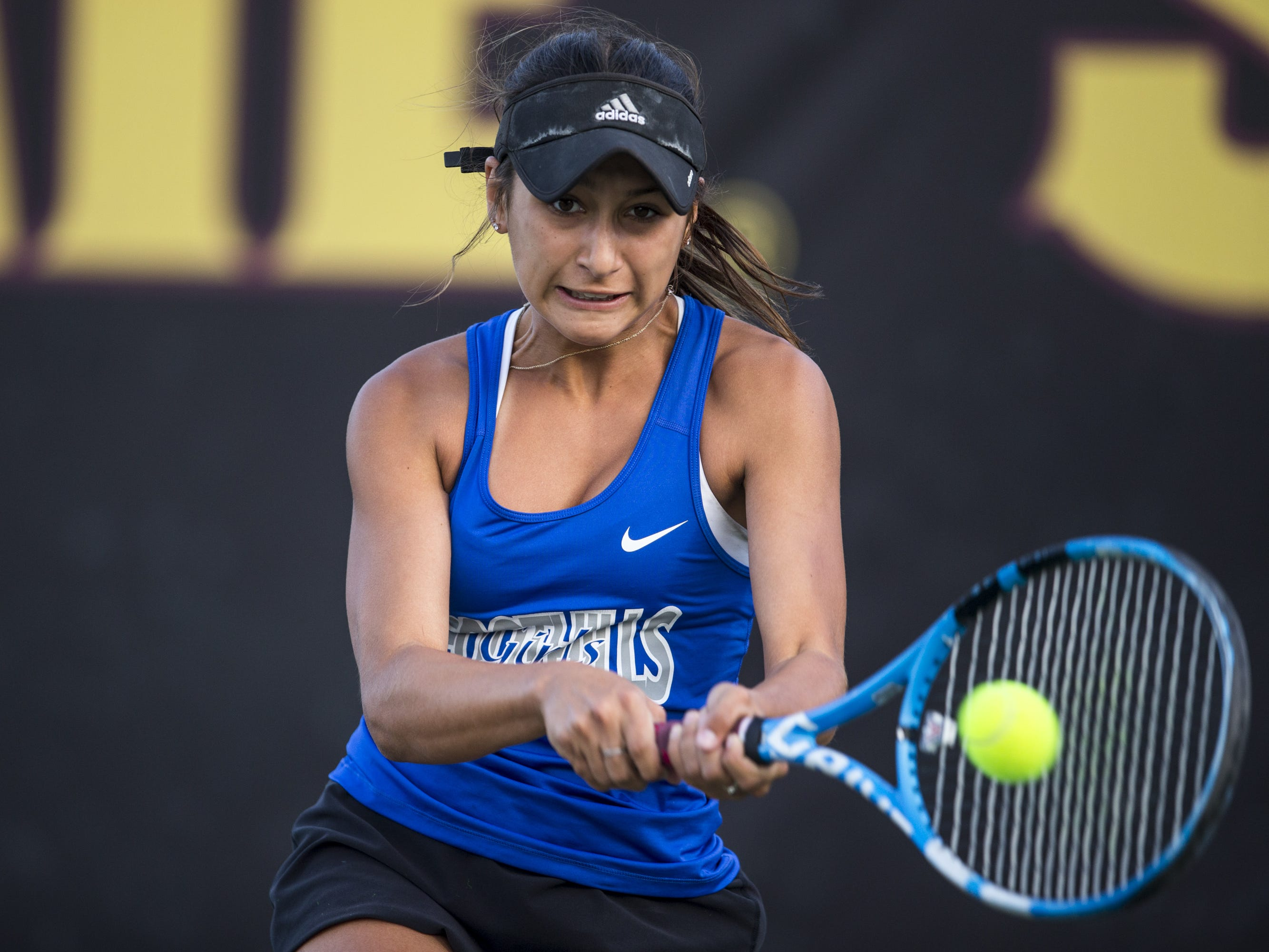 Catalina Foothills' Emily Flowers returns the ball against Catalina Foothills' Annabelle Mulick during the Division II Girls Tennis Singles State Championship on Monday, April 29, 2019, at Whiteman Tennis Center in Tempe, Ariz.