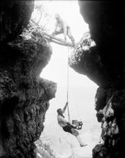 Emery (top) and Ellsworth Kolb, circa early-1900s, may have been the Grand Canyon's first extreme climbers, getting in unique and sometimes dangerous positions for a photograph.