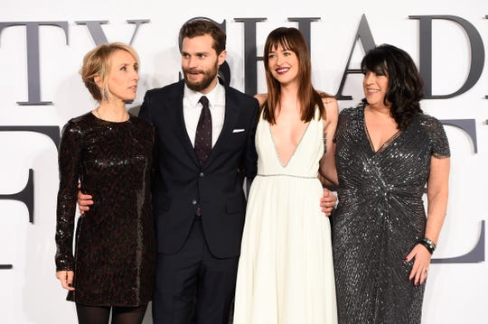 """E.L. James enjoys the glamorous life at the London premiere of """"Fifty Shades of Grey"""" on Feb. 12, 2015. Director Sam Taylor-Johnson (from left); stars Jamie Dornan and Dakota Johnson; and James."""