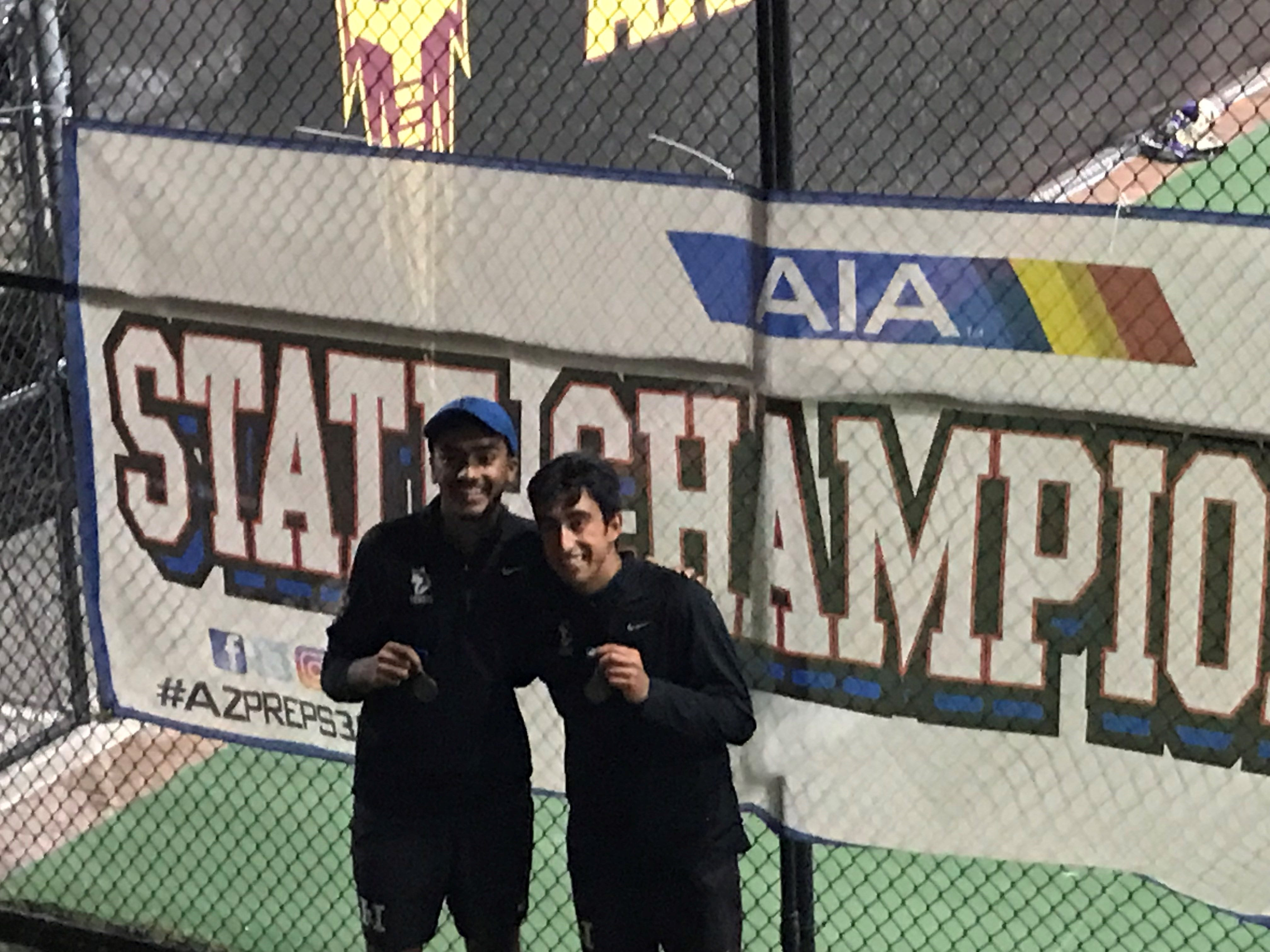 April 29, 2019; Hamilton doubles partners Neil Bhardwaja and Rahal Bhat (left to right) show off their medals after winning their second consecutive Division I doubles title match at ASU Whiteman Tennis Center.