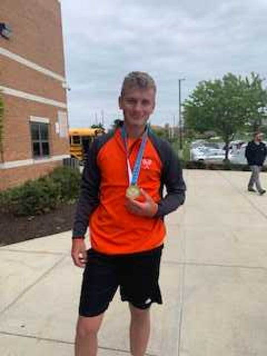 Palmyra's Ben Clary poses proudly with his medal after winning his third straight Mid-Penn 3A singles title on Monday.