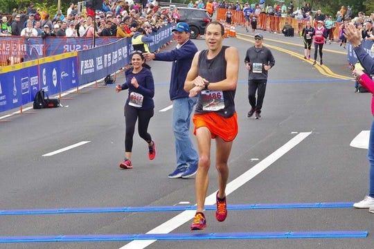 Port Huron High School graduate Adam Roach places second at the Big Sur International Marathon.