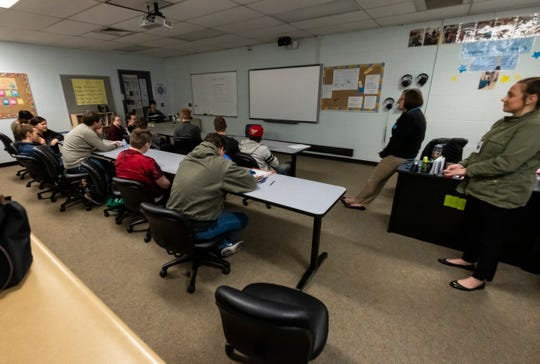 Next STEP program teacher Cora Heyboer, second from right, and Madeline Price, right, lead a group of students in introductions during class Tuesday, April 30, 2019.