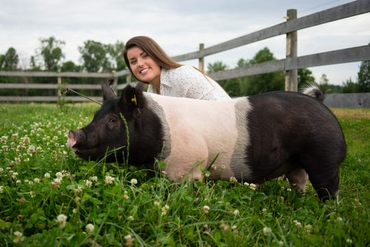 Carrie Brown of Columbus Township poses with her market hog before the 2018 St. Clair County 4-H and Youth Fair.