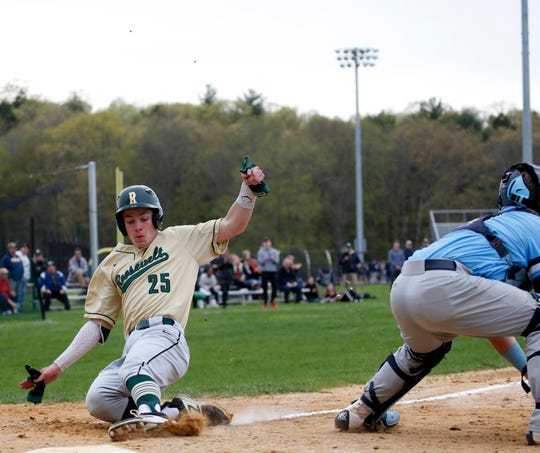 FDR's Jaden DeLawder slides home safely behind Saugerties' Ty Gallagher during an April 29 game.