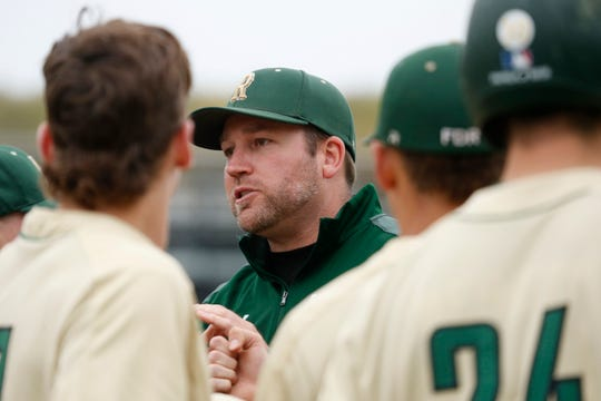 FDR's head coach Kory VanZandt talks to his players between innings during a game on April 29, 2019.