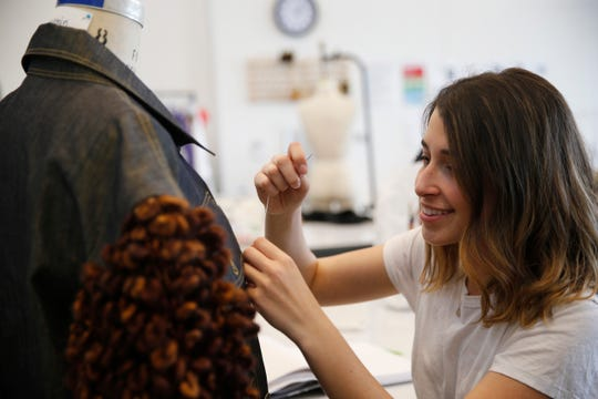 Marist College Fashion Program senior design major Joanna Musacchia works on one of her garments at Steel Plant Studios on April 25, 2019.