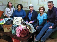 Evergreen Chorus members donate pocketbooks, toiletries to Grace Smith House women