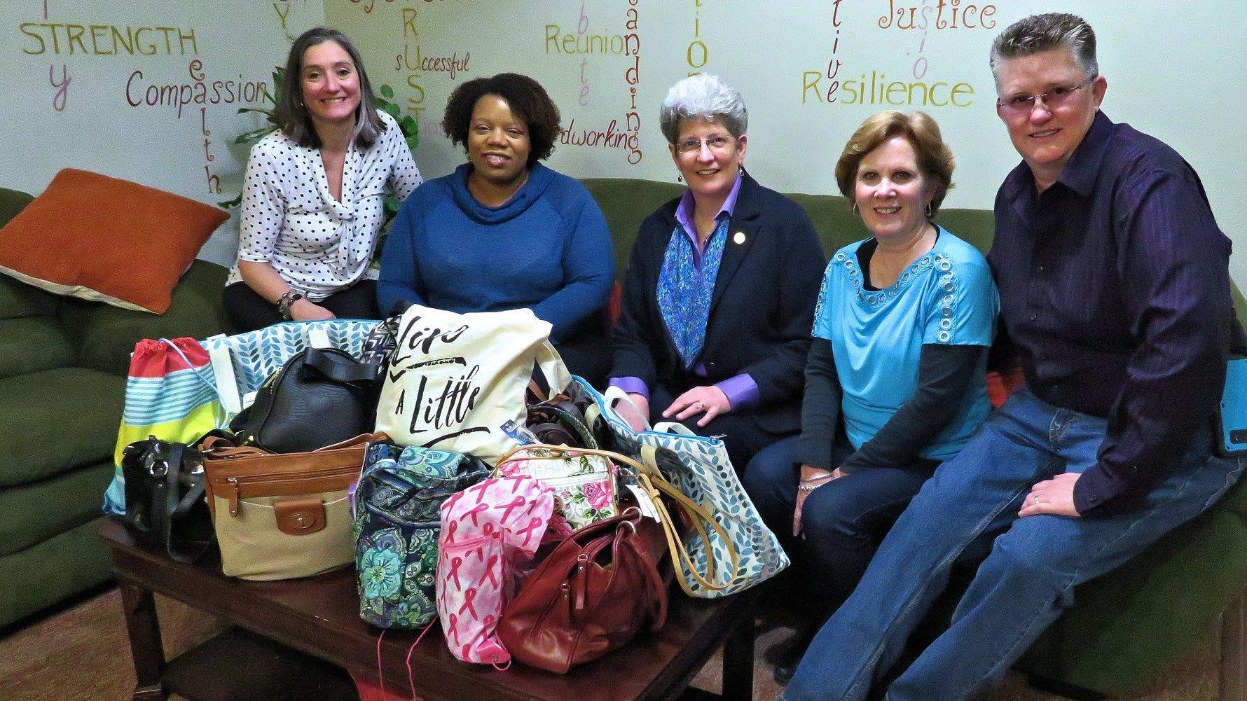 Evergreen Chorus members donate pocketbooks, toiletries to Grace Smith House women