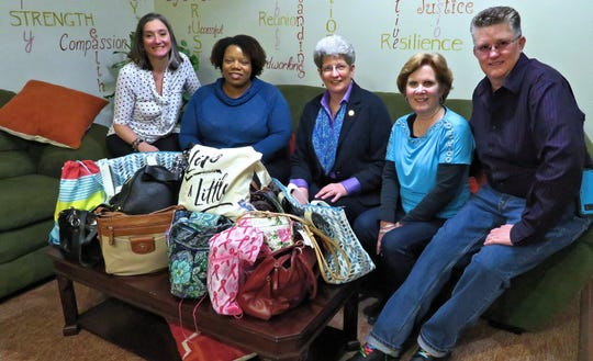 Left to right, Grace Smith House Executive Director Michele Pollack Rich and Residential Coordinator Kelly are shown with Evergreen Chorus members Nancy Clark, Patricia Sherry Miller and Kathy Gray. Evergreen Chorus members recently donated pocketbooks for women at Grace Smith House.
