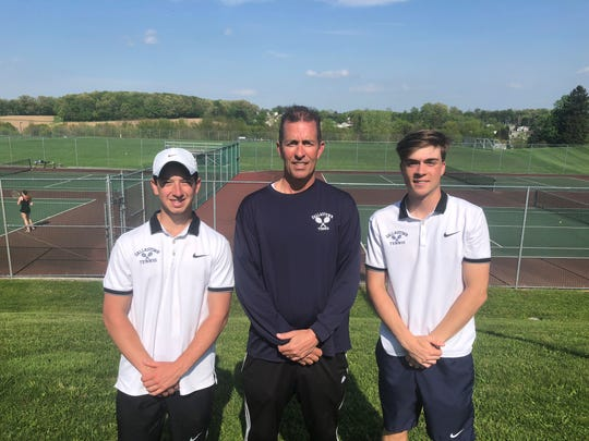 Dallastown's Jonathan Burns, left, and Sebastian May, right, pose with head coach Mark Koons after winning the York-Adams League Class 3-A doubles title for the second straight season.