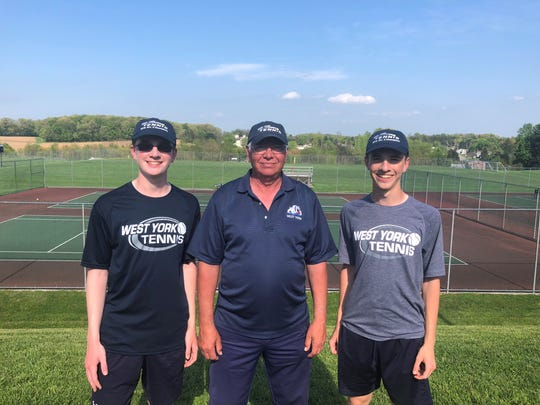 West York's Jack Citrone, left, and Augie Citrone, right, pose with head coach Pete Kerns after winning the York-Adams League Class 2-A doubles tournament.