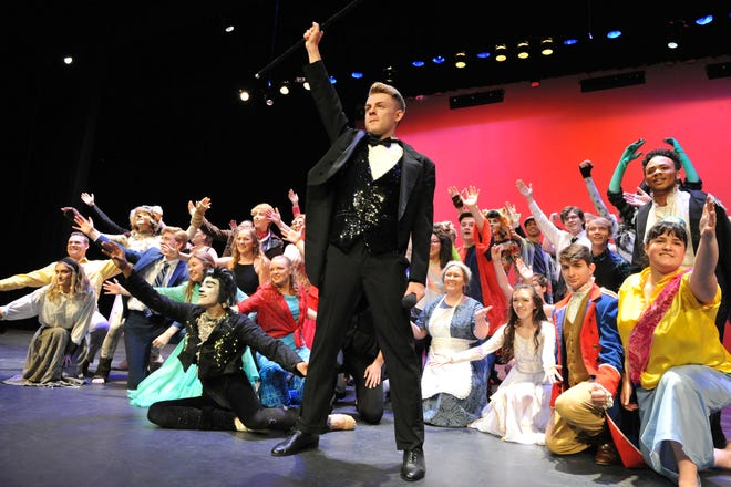 """Koby Fink, an """"Outstanding Male Performer"""" winner from Central York High School, leads an ensemble in a 2019 Encore showcase performance.   The annual showcase, held this year on Sunday, April 28, celebrates the spring high school musical season in York County. (Photo by: Mike Inkrote)"""