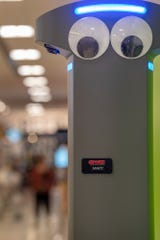 Marty the robot has big eyes and an employee name tag at the Giant supermarket.