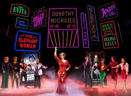 """This image released by Polk & Co. shows Santino Fontana, center, during a performance of """"Tootsie."""" The Tony Award nominations will be announced Tuesday. (Matthew Murphy/Polk & Co. via AP)"""
