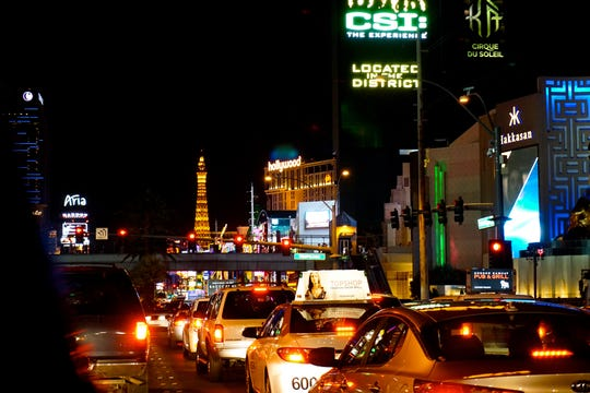 The Las Vegas Strip at night with traffic and lights.
