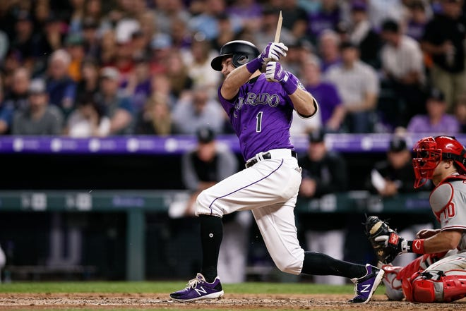 Rockies second baseman Garrett Hampson breaks his bat on a hit against the Phillies on April 20.